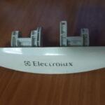 Ручка люка стиральной машины Electrolux с вертикальной загрузкой 1468572